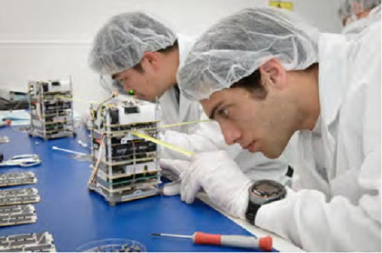 Spacecraft specialists prepare spacecraft to perform the Edison Demonstration of Smallsat Networks (EDSN) mission. (Credit: NASA Ames Research Center)