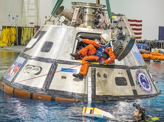 NASA astronaut Suni Williams exits a test version of the Orion spacecraft in the agency's Neutral Buoyancy Lab in Houston. The testing is helping NASA identify the best ways to efficiently get astronauts out of the spacecraft after deep space missions. (Credit: NASA)