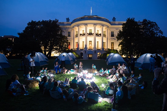 Astronaut Cady Coleman speaks to a group of fifty fourth-grade Girl Scouts about her time in space, at the first-ever White House Campout, hosted by the First Lady as part of the Let's Move! Outside initiative on Tuesday, June 30, 2015 in Washington, DC. NASA also provided telescopes and led a stargazing activity. {Credits: NASA/Aubrey Gemignani)