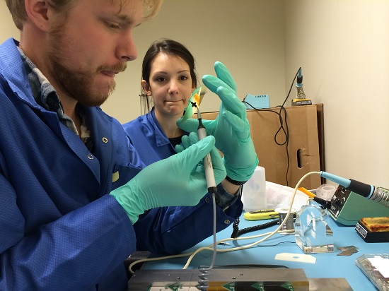 University of Colorado Boulder students handle the MinXSS solar cell. (Credits: University of Colorado Boulder)