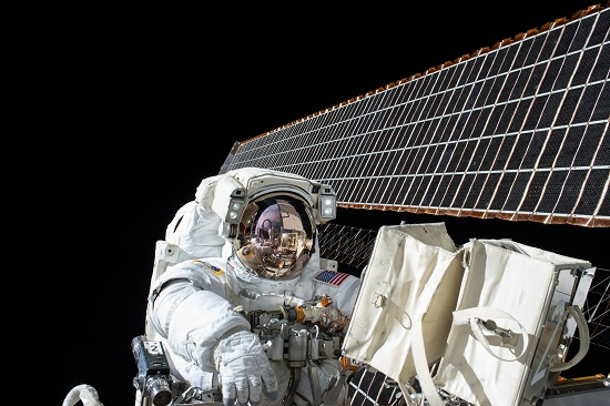 Working outside the International Space Station on the second spacewalk of Expedition 45, Nov. 6, 2015. (Credits: NASA)