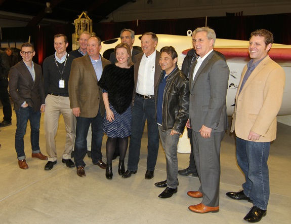 Stu Witt (center) stands with Congressman Kevin McCarthy, X Prize Chairman Peter Diamandis, Virgin Galactic CEO George Whitesides and others in front of a replica of SpaceShipOne. (Credit: Douglas Messier)