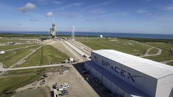 SpaceX's 300-foot long processing hangar, which stands at the base of Launch Pad 39A, and the upgraded launch infrastructure will support the needs of astronauts and ground support staff who will access SpaceX's Crew Dragon as it stands on the pad for launch to the International Space Station. (Credit: SpaceX)