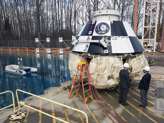 Administrator Charles Bolden stands next to Boeing's CST-100 capsule at Langely Research Center. (Credit: NASA)
