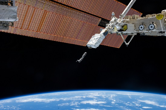 In February 2014, Planet Labs Inc. launched its first flock of Dove nanosatellites into space. Shown are two shoebox-sized Doves being ejected into low-Earth orbit from the International Space Station. The company's goal is for the flock to take a high-resolution snapshot of nearly the entire globe every 24 hours. (Credit: NASA)
