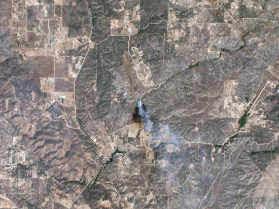 Planet Labs' Dove nanosatellites captured this image of the Sabina wildfire in Riverside County, California, on July 23, 2014, just 10 minutes after it was reported. The photo reveals the fire's size, the path it had burned, the wind direction, and its exact location. (Credit: Planet Labs Inc.)