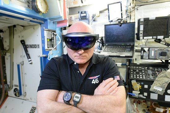 NASA astronaut Scott Kelly performing checkouts for NASA's Project Sidekick, which makes use of Microsoft's HoloLens device. (Credit: NASA)