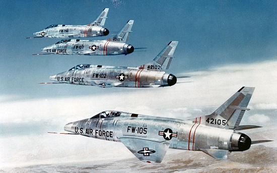 F-100 fighters flying in formation. (Credit: USAF)