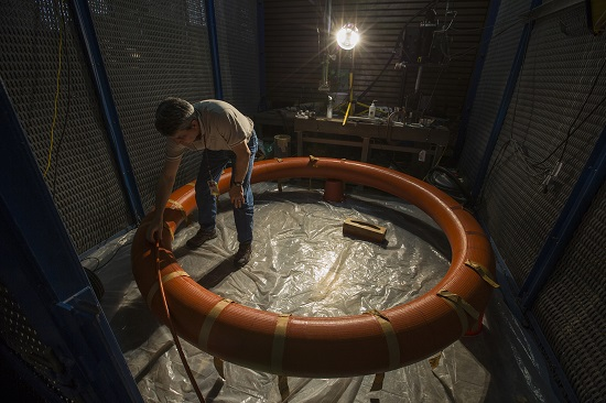 NASA's Hypersonic Inflatable Aerodynamic Decelerator (HIAD) lead engineer Keith Johnson inflates a 9-foot diameter test article of the technology. HIAD could give NASA more options for future planetary missions, because it could allow spacecraft to carry larger, heavier scientific instruments and other tools for exploration. (Credit: NASA/David C. Bowman)