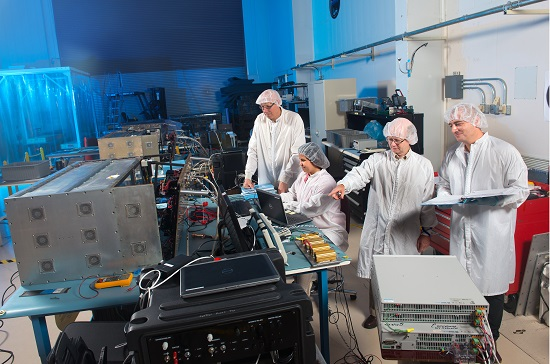 A team of scientists and engineers tests the components of Saffire I and Saffire II. (Credit: NASA)