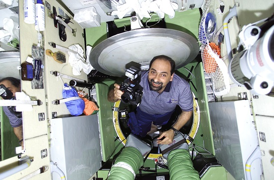 Astronaut Umberto Guidoni, STS-100 mission specialist representing the European Space Agency (ESA), records activity on the Zvezda Service Module following hatch opening and the reunion of STS-100 crew members with the three members of the Expedition Two crew. This image was taken with a digital still camera. (Credit: ESA)