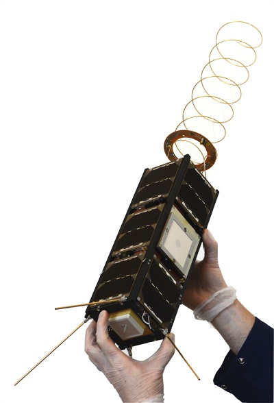 Led by GomSpace in Denmark, GomX-3 is a 3-unit CubeSat mission to demonstrate aircraft ADS-B signal reception and geostationary telecommunication satellite spot beam signal quality using an L-band reconfigurable software-defined radio receiver. A miniaturised high data rate X-band transmitter developed by Syrlinks and funded by France's CNES space agency is being flown as a third-party payload. The satellite was deployed from the International Space Station on 5 October 2015. The distinctive helical antenna seen here has subsequently enabled GomX-3 to perform millions of detections of aircraft in flight. (Credit: GomSpace)