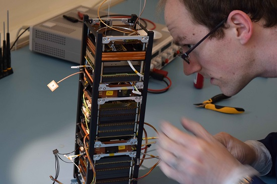 The technology-testing GomX-3 under construction. It was developed for ESA by GomSpace in Aalborg, Denmark, which is one of Europe's main CubeSat manufacturers. A 'three-unit' CubeSat, it measures 10x10x30 cm with an approximate mass of 3 kg, with payloads to detect signals from aircraft and telecom satellites. (Credit: http://davidgerhardt.com)
