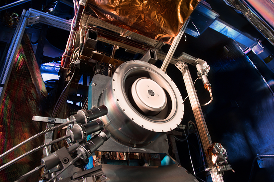 Advanced solar electric propulsion will be needed for future human expeditions into deep space, including to Mars. Shown here is a 13-kilowatt Hall thruster being evaluated at NASA's Glenn Research Center in Cleveland. Hall thrusters trap electrons in a magnetic field and use them to ionize the onboard propellant. It uses 10 times less propellant than equivalent chemical rockets. (Credit: NASA)