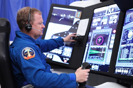 Astronaut Eric Boe runs mission scenarios in a Boeing part-task trainer that simulates CST-100 Starliner missions like those that will be flown for NASA's Commercial Crew Program. (Credit: NASA/Dmitri Gerondidakis)