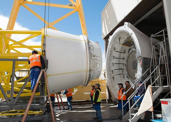 Engineers prepare a five-segment sold rocket booster for a test firing. (Credit: Orbital ATK)