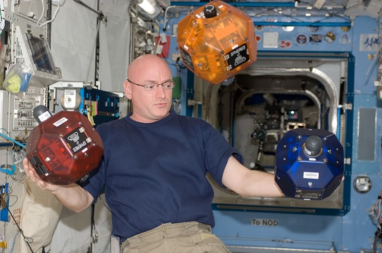 NASA astronaut Scott Kelly works with SPHERES on the International Space Station. (Credits: NASA/ISS)