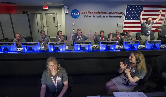 Juno team members celebrate after they received confirmation from the spacecraft that it has successfully entered orbit of Jupiter, Monday, July 4, 2016 in mission control of the Space Flight Operations Facility at the Jet Propulsion Laboratory in Pasadena, CA. The Juno mission launched August 5, 2011 and will orbit the planet for 20 months to collect data on the planetary core, map the magnetic field, and measure the amount of water and ammonia in the atmosphere. (Credit: NASA/Aubrey Gemignani)