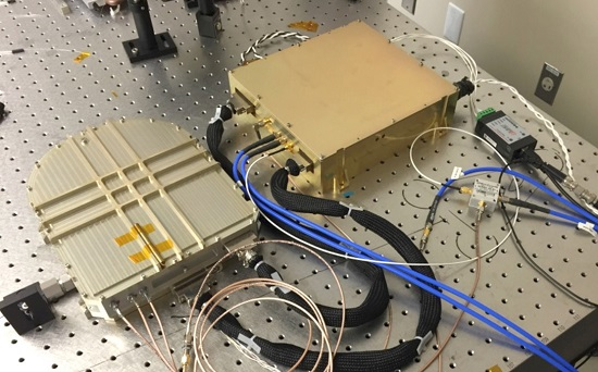 Laser transmitter assembly with module on the left in the laser optical module; the laser electrical module is shown on the right. (Credit: NASA)
