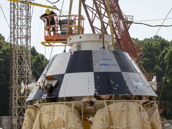 A mock-up of Boeing's CST-100 Starliner is seen with its airbags deflated following touch down. The airbags deflate to absorb the impact of touch down. (Credit: NASA/Langley Research Center)