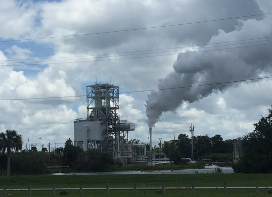 Steam billows from the engine test stand as the RL10 engine fires. (Credit: Aerojet Rocketdyne)