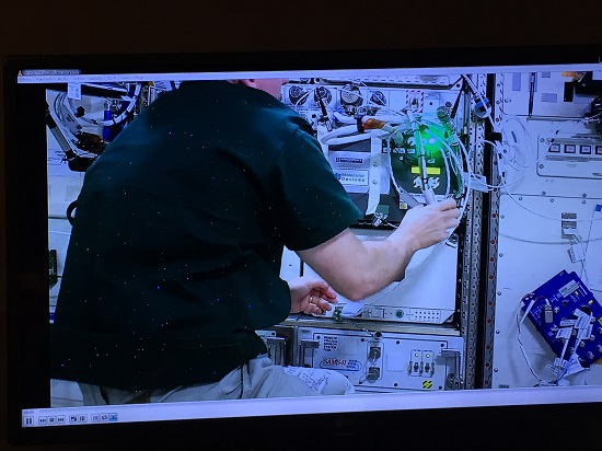 Astronaut Jeff Williams installs TangoLab-1 aboard the International Space Station. (Credit: Space Tango)
