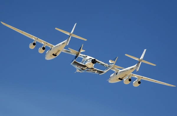 The second SpaceShipTwo is carried aloft by WhiteKnightTwo on its first captive carry flight. (Credit: Virgin Galactic)
