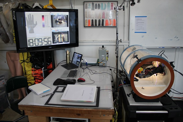 Mechanical Counter Pressure glove test evaluation setup including glove chamber, video documentation, and pressure visualization. (Credit: Final Frontier Design)