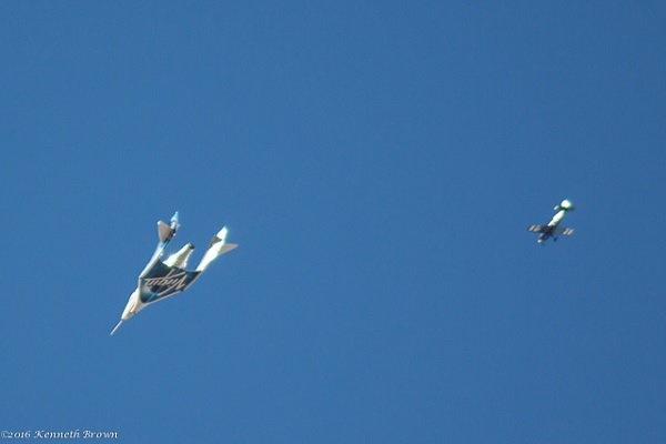 SpaceShipTwo glides through the Mojave sky followed by an Extra chase plane. (Credit; Ken Brown)
