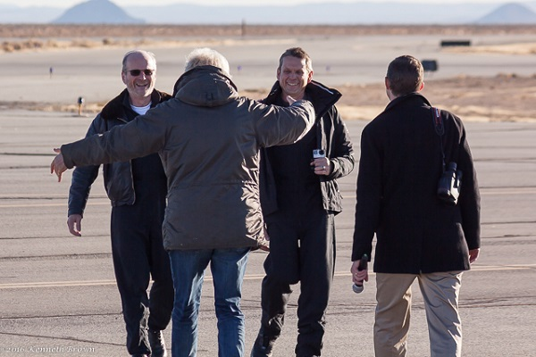 Richard Branson moves to embrace SpaceShipTwo pilots David Mackay and Mark Stucky. To Branson's right in Virgin Galactic CEO George Whitesides. (Credit: Kenneth Brown)