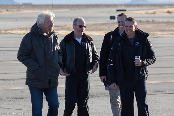 Richard Branson (l) and George Whitesides (r) walk with SpaceShipTwo pilots David Mackay and Mark Stucky after a successful glide flight. (Credit: Kenneth Brown)