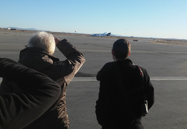 Richard Branson and George Whitesides gaze out at SpaceShipTwo after it came to a stop on Runway 12. (Credit: Douglas Messier)