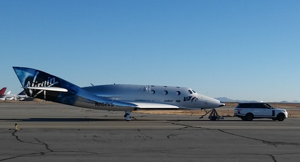 SpaceShipTwo being towed back to Virgin Galactic's FAITH hangar after a successful glide flight. (Credit: Douglas Messier)