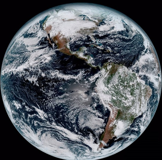 This composite color full-disk visible image of the Western Hemisphere was captured from NOAA GOES-16 satellite at 1:07 pm EST on Jan. 15, 2017 and created using several of the 16 spectral channels available on the satellite's sophisticated Advanced Baseline Imager. The image, taken from 22,300 miles above the surface, shows North and South America and the surrounding oceans. (Credits: NOAA)
